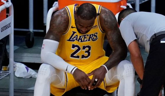 Los Angeles Lakers forward LeBron James sits on the bench during the fourth quarter of Game 6 of his team's first-round playoff series against the Phoenix Suns on Thursday at Staples Center.