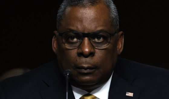 Secretary of Defense Lloyd Austin listens during a Senate Armed Services Committee hearing on Capitol Hill in Washington on Thursday.
