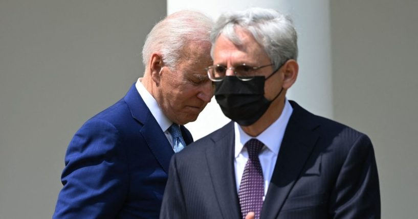 President Joe Biden and Attorney General Merrick Garland take part in an event about gun violence prevention in the Rose Garden of the White House in Washington, D.C., on April 8.