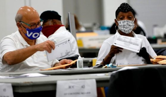 Election workers count absentee ballots for the 2020 general election at TCF Center in Detroit on Nov. 4.