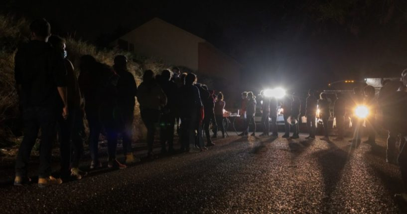 Border Patrol agents process immigrant families in Roma, Texas, after they illegally crossed the Rio Grande from Mexico on April 29.