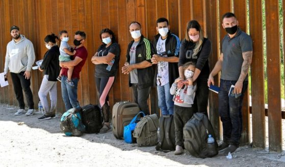 Migrants attempting to cross into the U.S. from Mexico are pictured at the border on May 21, 2021, in San Luis, Arizona.