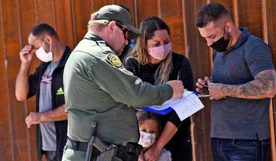 Migrants who illegally crossed into the U.S. from Mexico are detained by U.S. Customs and Border Protection in San Luis, Arizona, on May 21.