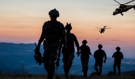 """On Fox News' Tucker Carlson's show, investigative journalist Daniel Greenfield says what his research looking into the workings of the """"woke"""" Pentagon has revealed. The above stock photo shows a military mission at twilight."""