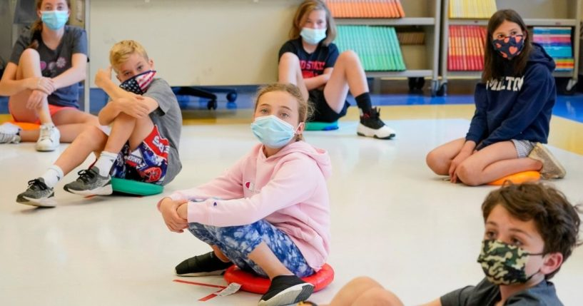 Fifth-graders wear face masks and are socially distanced during a music class at Milton Elementary School in Rye, New York, on May 18.