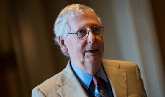 Senate Minority Leader Mitch McConnell walks to his office after speaking on the Senate floor at the U.S. Capitol on June 14, 2021.