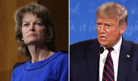 Former President Donald Trump, right, announced Monday that he plans to travel to Alaska to campaign against Republican Sen. Lisa Murkowski's re-election.