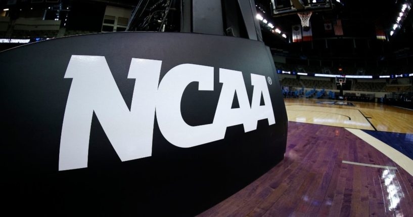 The NCAA logo is seen on the basket stanchion before the game between the Oral Roberts Golden Eagles and the Florida Gators in the second-round game of the 2021 NCAA Men's Basketball Tournament at Indiana Farmers Coliseum on March 21, 2021, in Indianapolis.
