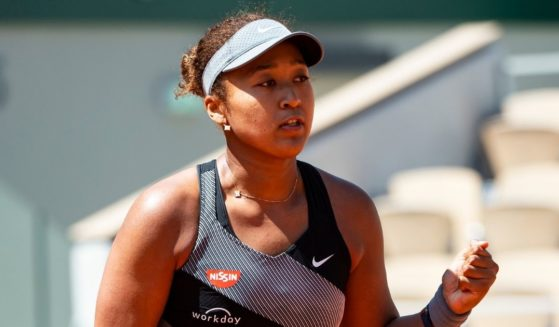 Naomi Osaka of Japan celebrates during her match against Patricia Maria Țig of Romania in the first round of the women's singles at Roland Garros in Paris on Sunday.