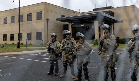 Minnesota National Guard and State Troopers stand guard outside the Brooklyn Center Police Station after a police officer shot and killed 20-year-old Daunte Wright during a traffic stop in Brooklyn Center, Minneapolis on April 12, 2021.