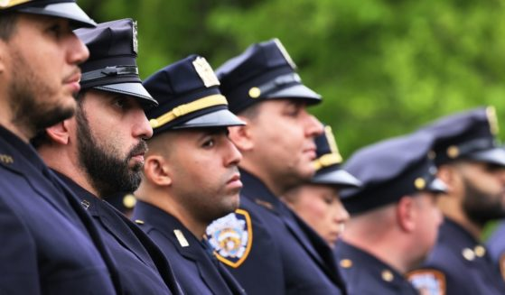 New York Police Department officers line up during a funeral service on May 4, 2021, in Greenlawn, New York.
