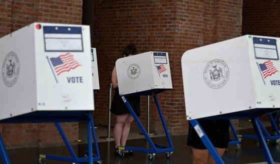 Residents vote in the New York City mayoral primary election at the Brooklyn Museum on June 22, 2021, in New York City.