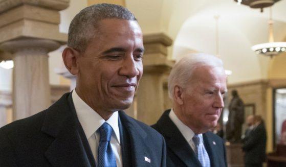 Barack Obama and Joe Biden walk through the Capitol for Donald Trump's inauguration ceremony in Washington on Jan. 20, 2017.
