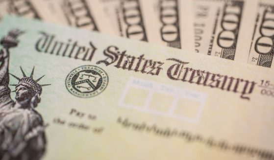 This stock photo shows a stimulus check that was sent out to American citizens during the COVID-19 pandemic. Some experts now believe as much as $400 billion has been paid out in fraudulent unemployment claims.