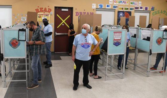 People vote at the Veterans Memorial Leisure Center on Nov. 3, 2020, in Las Vegas.