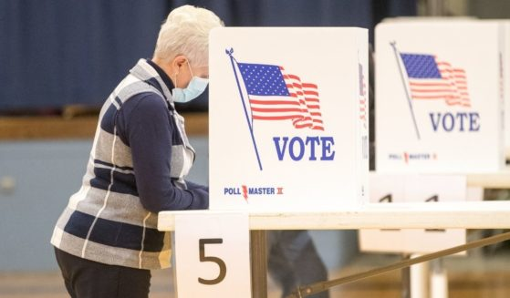 A woman fills out her ballot on Nov. 3, 2020, in Hermon, Maine.