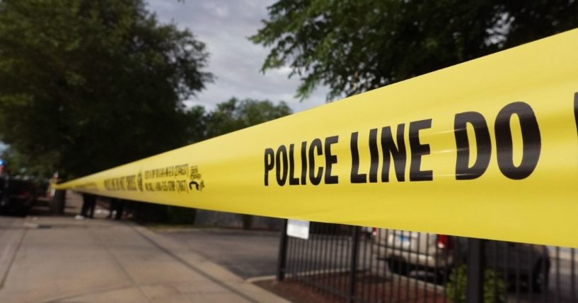 Police tape surrounds a crime scene where three people were shot at the Wentworth Gardens housing complex in the Bridgeport neighborhood on Wednesday in Chicago.