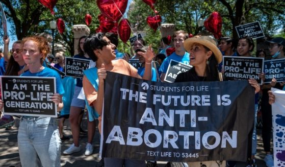 Pro-life demonstrators stand near the gate of the Texas state capitol on May 29, 2021, in Austin, Texas.