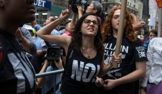 Sunsara Taylor, center, leads protesters from RefuseFascism.org outside of Trump Tower on Aug. 14, 2017, in New York City.