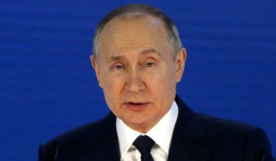 Russian President Vladimir Putin delivers his annual address to the Federal Assembly in Moscow on April 21.