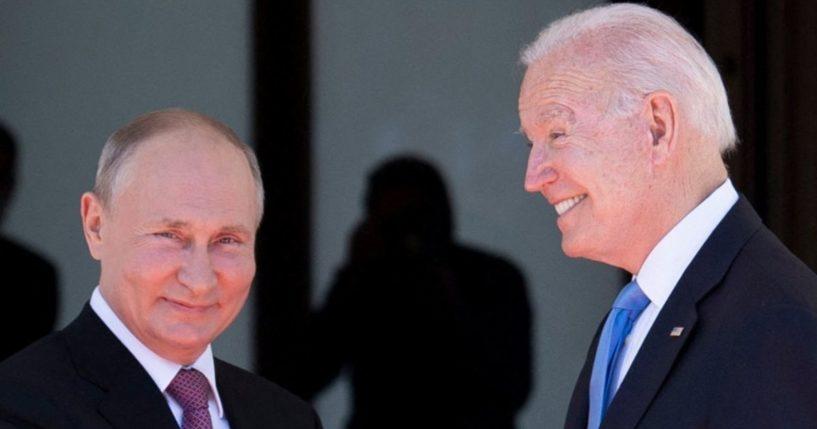 Russian President Vladimir Putin shakes hands with President Joe Biden prior to the U.S.-Russia summit at the Villa La Grange in Geneva on Wednesday.