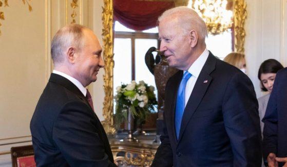 President Joe Biden (2L) and Russian President Vladimir Putin shake hands as Swiss President Guy Parmelin (R) looks on during the U.S.-Russia summit at Villa La Grange on June 16, 2021 in Geneva, Switzerland.