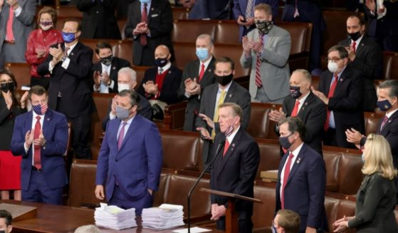Rep. Paul Gosar of Arizona and Sen. Ted Cruz of Texas are applauded by Republican members of Congress after objecting to the certification of the Electoral College results during a joint session of Congress on Jan. 6, 2021, in Washington, D.C.