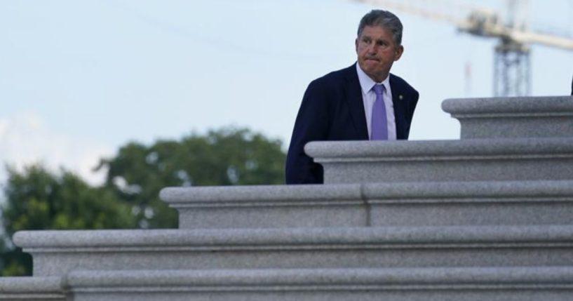 Democratic Sen. Joe Manchin of West Virginia walks up the steps of Capitol Hill in Washington, D.C., on Monday.
