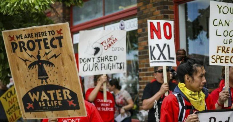A procession protesting against the Keystone XL pipeline makes its way to Andrew W. Bogue Federal Courthouse in Rapid City, South Dakota, on June 12, 2019.