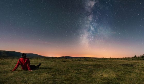 """This stock photo portrays a man looking up at the sky. Scientists have released approximate times when the """"Ring of Fire"""" phenomenon will be visible to sky-watchers."""