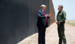 President Donald Trump speaks with Border Patrol Chief Rodney Scott, right, as they participate in a ceremony commemorating the 200th mile of border wall at the U.S.-Mexico border in San Luis, Arizona, on June 23, 2020.