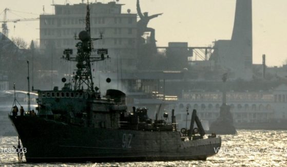 Russia says it fired warning shots when a British destroyer crossed into waters it claims as its territory in the Black Sea near Ukraine on Wednesday.