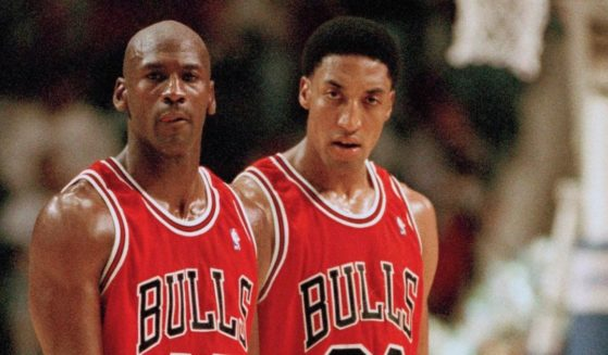 Then-Chicago Bulls players Michael Jordan, left, and Scottie Pippen return to the floor after a timeout in the fourth quarter against the Indiana Pacers, on March 19, 1995, in Indianapolis.