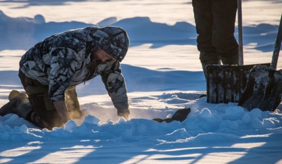 Villagers harvest ice from a local lake near the settlement of Oy, some 70 km south of Yakutsk, with the air temperature at about -41 degrees Celsius, on Nov. 27, 2018.
