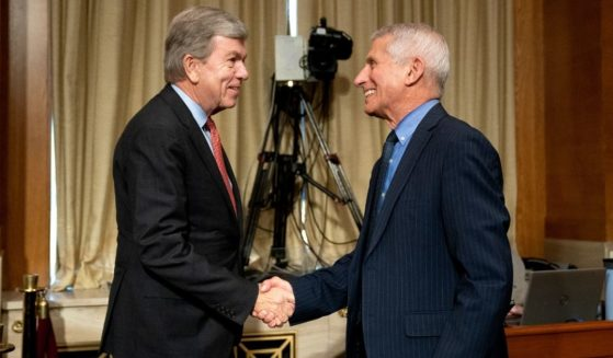 Republican Sen. Roy Blunt of Missouri, left, shakes hands with Dr. Anthony Fauci, Director of the National Institute of Allergy and Infectious Diseases, following a Senate Appropriations Subcommittee hearing on May 26, 2021, on Capitol Hill in Washington, D.C.