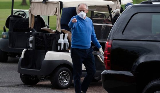Presidential counselor Steve Ricchetti gestures after playing a round of golf with President Joe Biden in Wilmington, Delaware, on April 17, 2021.