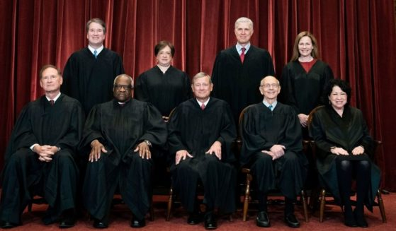 Members of the Supreme Court pose for a group photo at the Supreme Court in Washington on April 23, 2021.