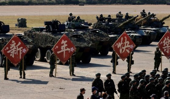 Taiwan's Army troops display signs for photographs after a drill in Hsinchu military base ahead of the Chinese New Year holiday on Jan. 19, 2021.