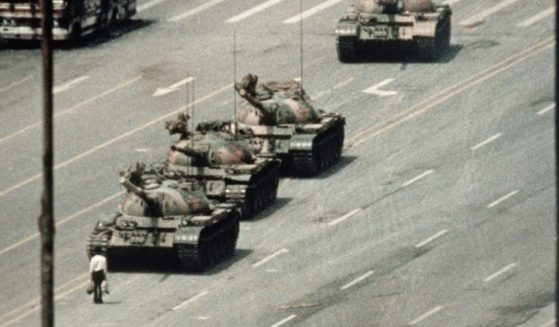 """A demonstrator, now immortalized as """"Tank Man,"""" blocks the path of a tank convoy along the Avenue of Eternal Peace near Tiananmen Square in Beijing on June 4, 1989."""