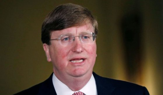 Mississippi Republican Gov. Tate Reeves delivers a televised address prior to signing a bill retiring the last state flag in the United States with the Confederate battle emblem, at the Governor's Mansion June 30, 2020, in Jackson, Mississippi.