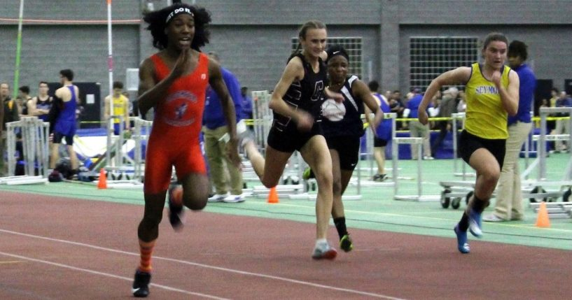 Bloomfield High School transgender athlete Terry Miller, left, wins the final of the 55-meter dash in the Connecticut girls Class S indoor track meet at Hillhouse High School in New Haven on Feb. 7, 2019.