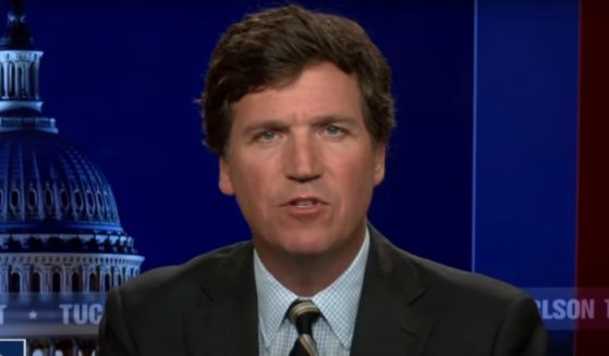 """Fox News host Tucker Carlson discusses spying allegations on his """"Tucker Carlson Tonight"""" program on Tuesday."""