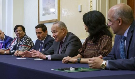 Senate Majority Leader Chuck Schumer is flanked by Texas Rep. Trey Martinez Fischer of San Antonio, left, and Texas Sen. Carol Alvarado of Houston as he meets with Texas Democratic lawmakers at the Capitol in Washington on Tuesday.