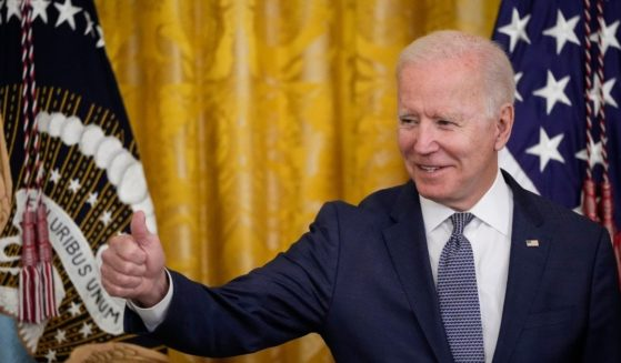 President Joe Biden gives the thumbs up to the audience in the East Room of the White House on Thursday in Washington, D.C.