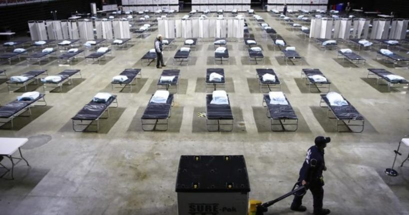 A worker moves items at a Federal Medical Station for hospital surge capacity set up at Temple University's Liacouras Center in Philadelphia on March 30, 2020.