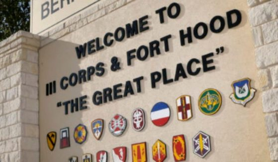 In this July 9, 2013, file photo, traffic flows through the main gate past a welcome sign in Fort Hood, Texas.
