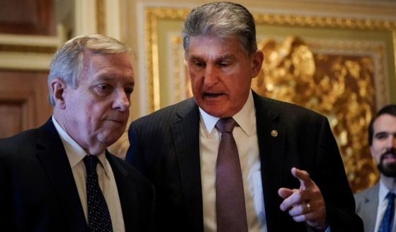 West Virginia Sen. Joe Manchin, right, is pictured with fellow Democrat Sen. Dick Durbin of Illinois in a file photo from Jan. 28, 2020.