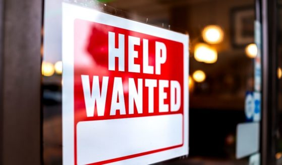 """A """"help wanted"""" sign on a door."""