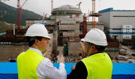 A British official talks with an official of the Taishan Nuclear Power Plant in Guangdong province in 2013.
