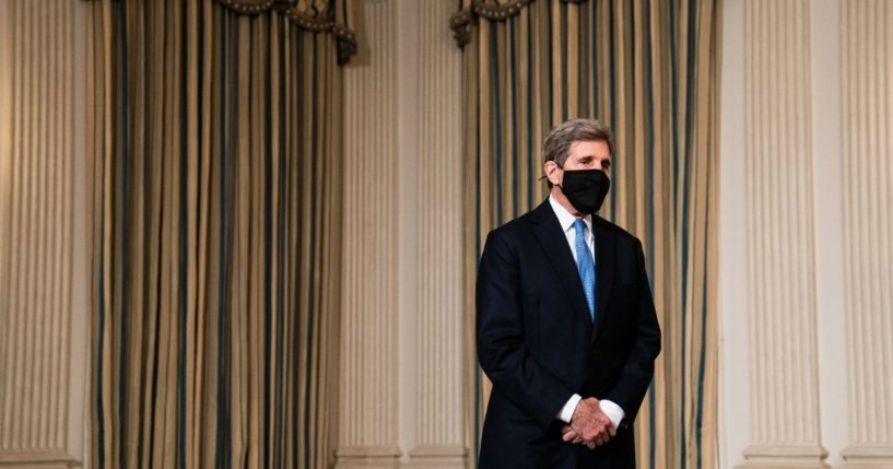 Special Presidential Envoy for Climate John Kerry listens as President Joe Biden speaks in January 2021 in the White House about climate change.